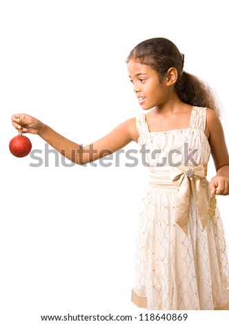 adorable girl decorates christmas tree ornaments (isolated) - stock photo