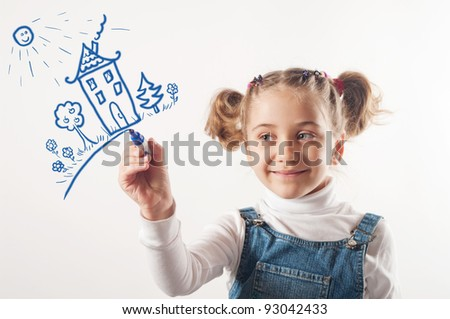 Adorable girl drawing a house - stock photo