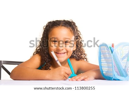adorable girl drawing at her desk - stock photo