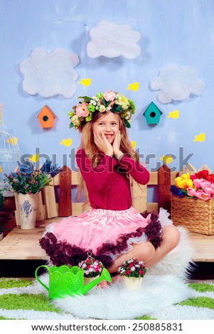 Adorable girl in a wreath of flowers, March 8, Mother's Day, International Women's Day - stock photo