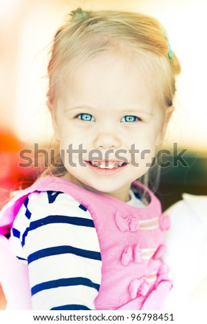 Adorable girl laughing and having fun - stock photo