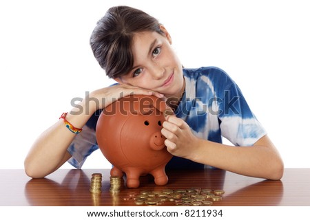 adorable girl putting its savings in your money box - stock photo