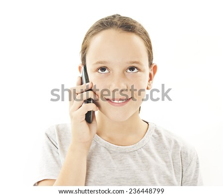 Adorable girl talking on the phone looking up. Isolated on white background  - stock photo