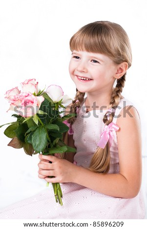 adorable girl with a bouquet of pink roses isolated on white background - stock photo