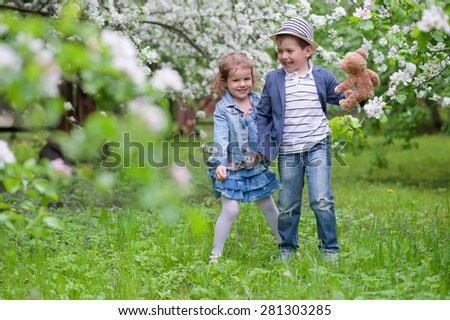 Adorable girl with a boy in the park - stock photo
