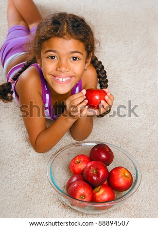 adorable girl with apples - stock photo