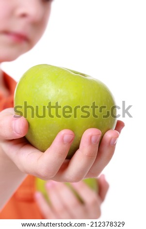adorable girl with green apples on white background/portrait of little girl with apples - stock photo