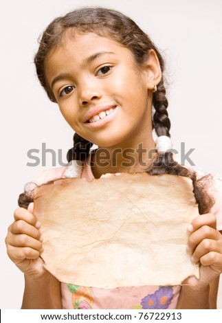 adorable girl with old paper in her hands - stock photo
