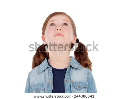 Adorable girl with pigtails looking up isolated on a white background - stock photo