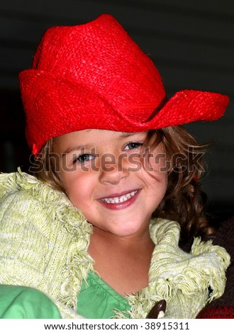 adorable girl with red cowboy hat - stock photo