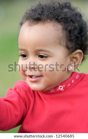 adorable happy baby a over green background - stock photo
