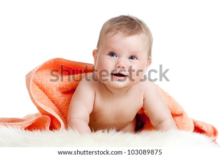 Adorable happy baby girl in colorful towel - stock photo