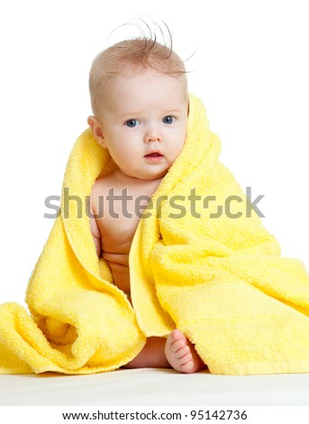Adorable happy blue-eyed baby in colorful towel - stock photo