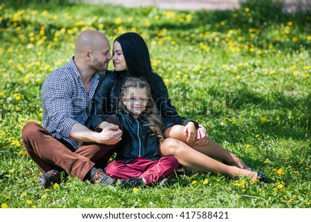 Adorable happy family in summer - stock photo