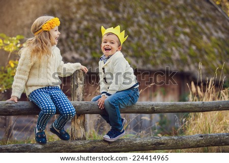 Adorable happy kids outdoor on sunny day - stock photo
