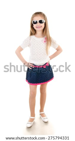 Adorable happy little girl in sunglasses posing isolated on a white - stock photo