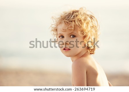 Adorable happy little girl on beach vacation, close up portrait - stock photo