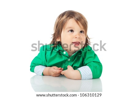 Adorable happy little kid, 2 years old boy, sitting on the floor on his belly, wearing shirt and jeans. High resolution image isolated on white background with copy space. Studio shot. - stock photo