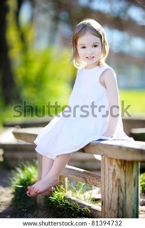 Adorable happy preschooler girl smiling outdoors - stock photo