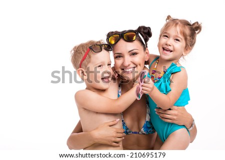 Adorable happy two children with her mother on a white background - stock photo