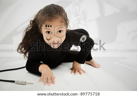 Adorable hispanic african american preschool cyborg child on floor. - stock photo