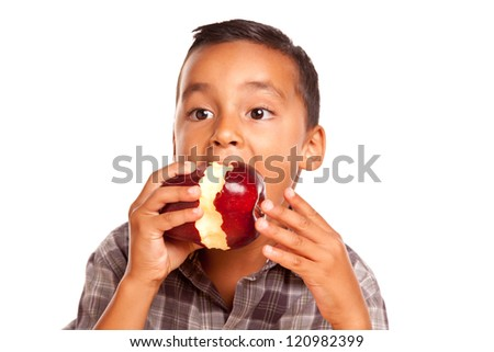 Adorable Hispanic Boy Eating a Large Red Apple Isolated on a White Background. - stock photo