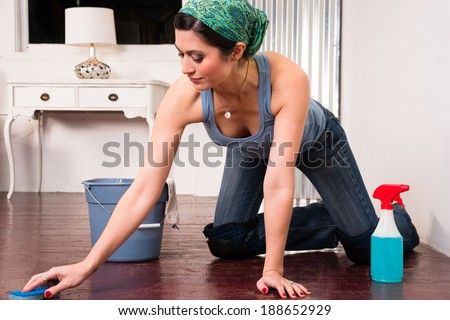 Adorable Housewife Doing Cleaning Chores Scrubbing Wood Floor Hands Knees - stock photo