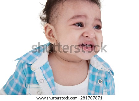 Adorable Indian baby boy crying over white background - stock photo
