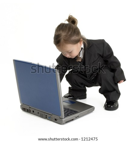 Adorable Japanese American toddler in suit with laptop.