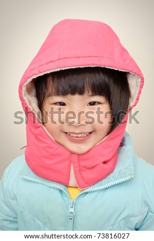 Adorable Japanese girl smiling with red hat, closeup portrait of Asian baby. - stock photo