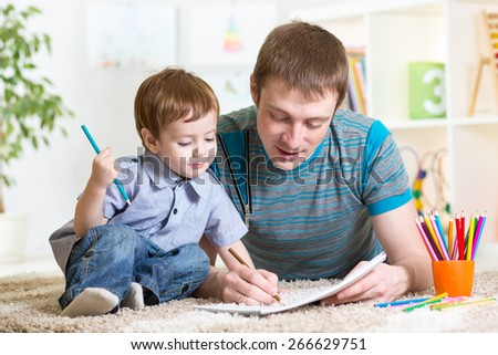 adorable kid child boy drawing with colorful pencils - stock photo