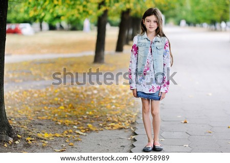 Adorable kid girl don't want to share ice cream to father. Family lifestyle - stock photo