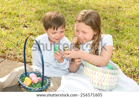 Adorable kids outdoors with their Easter baskets - stock photo