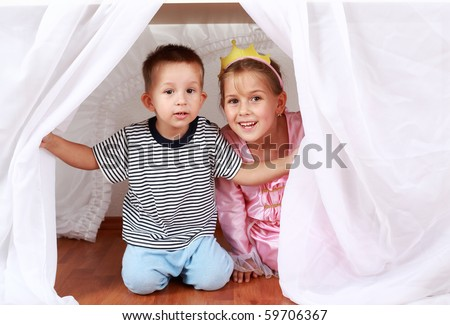 Adorable kids playing hide-and-seek at home - stock photo