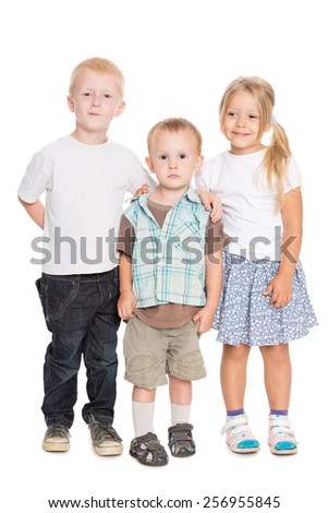 Adorable kids - two brothers and a sister are in full growth - stock photo