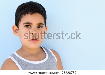 Adorable latin child with a thoughtful expression - stock photo
