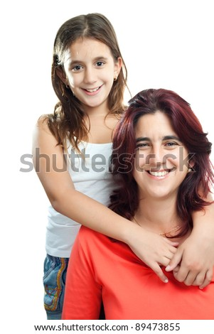 Adorable latin girl hugging her young mother isolated on a white background - stock photo