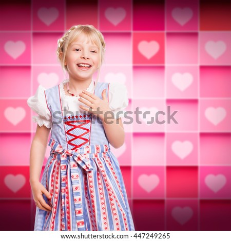 adorable laughing young girl in bavarian dirndl - stock photo