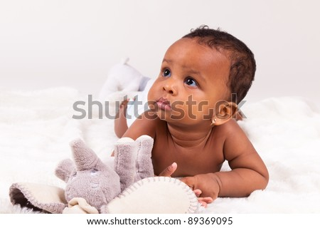 Adorable little african american baby girl  lying down - stock photo