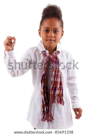Adorable little African Asian girl holding a pen, isolated on white background - stock photo