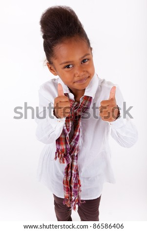 Adorable little African Asian girl  making thumbs up - stock photo