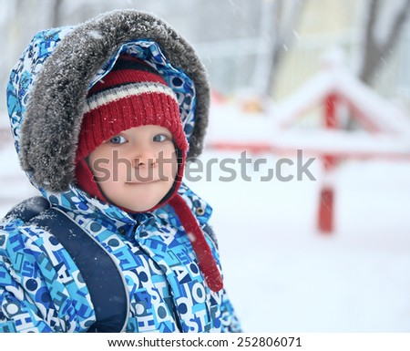 Adorable little baby boy in winter park - stock photo