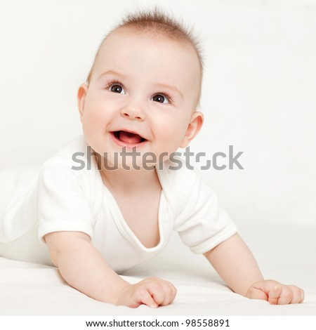 Adorable little baby smiling, on white background - stock photo