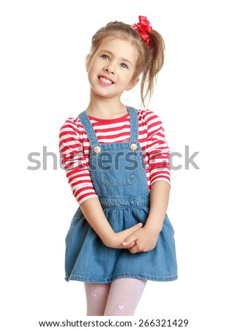 Adorable little blond girl in a denim dress.- isolated on white background - stock photo