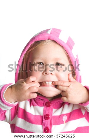 Adorable little blond girl making a funny face in a hooded jacket - stock photo