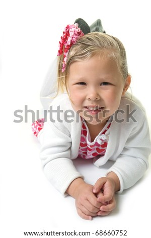 Adorable little blond girl posing in the studio wearing red and pink hearts for Valentine's Day - stock photo