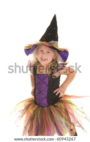 Adorable little blond girl smiling dressed as a beautiful witch for Halloween - stock photo