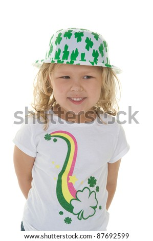 Adorable little blond girl smiling wearing St. Patrick's day clothing in the studio - stock photo