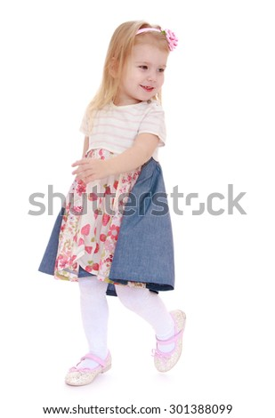 Adorable little blonde girl goes somewhere, she is busy about their business-Isolated on white background - stock photo