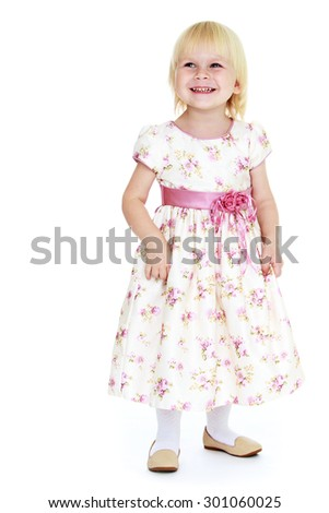 Adorable little blonde girl with short hair in a long flowered dress with pink sash tied-Isolated on white background - stock photo